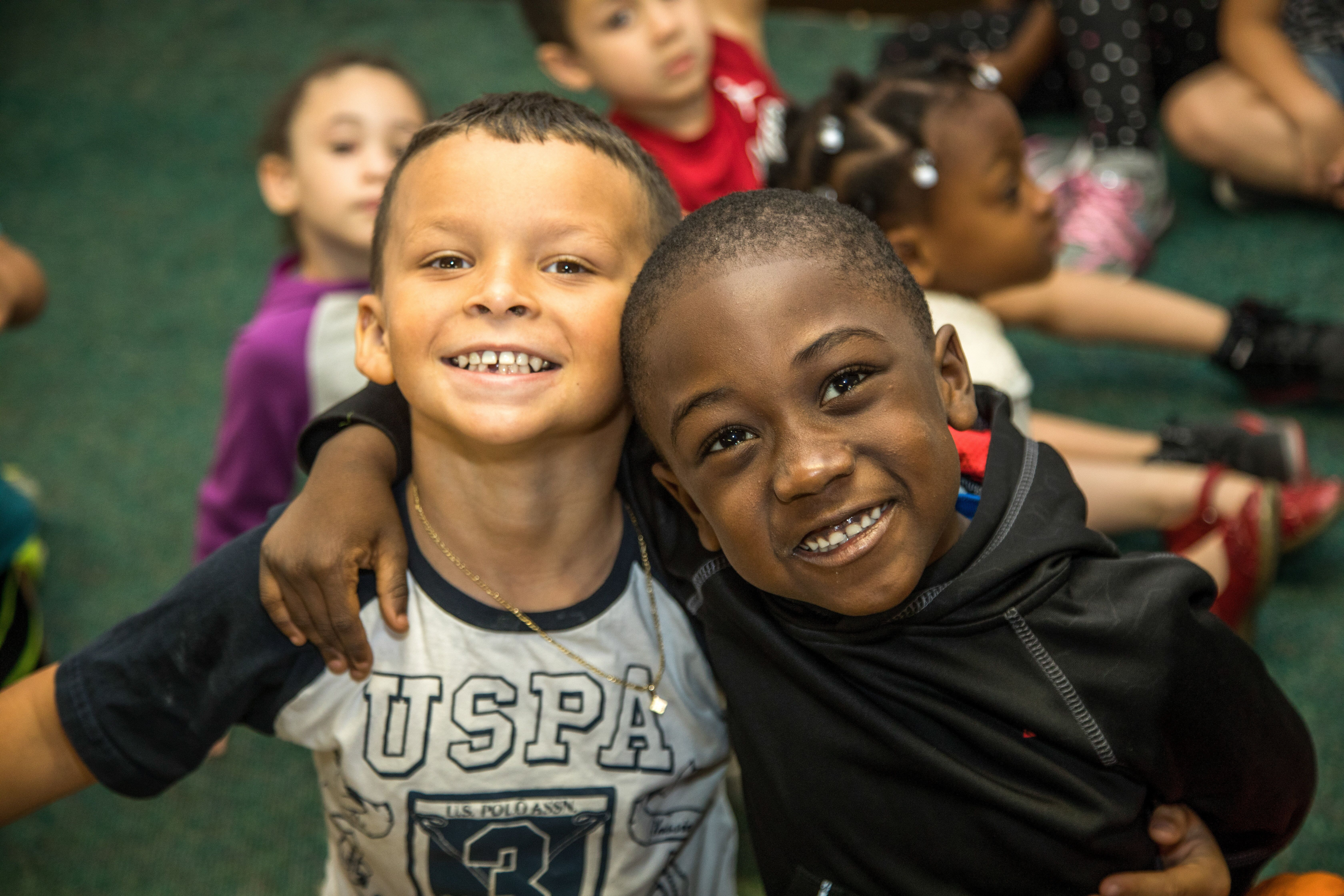 Two smiling boys at a Preschool & Daycare Serving Palm Springs, Lake Worth, West Palm Beach, FL