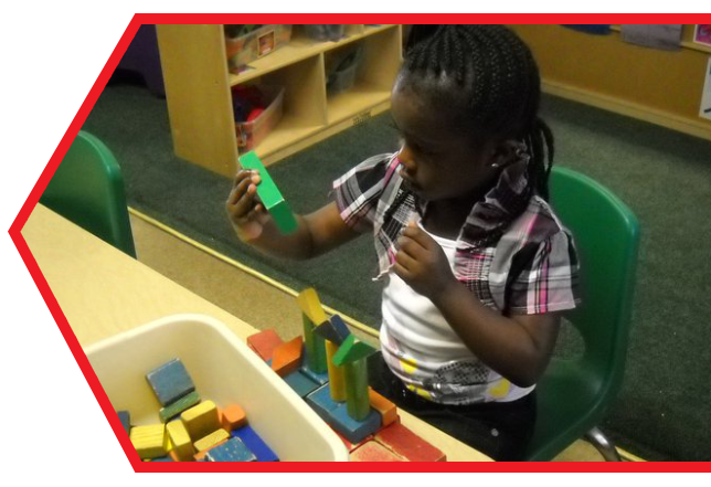 African-american child playing building blocks at a Preschool & Daycare Serving Palm Springs, Lake Worth, West Palm Beach, FL