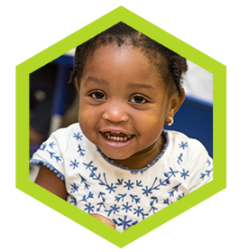 Happy beautiful African-american at a Preschool & Daycare Serving Palm Springs, Lake Worth, West Palm Beach, FL