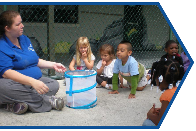 Teacher and diverse kids having a class activity outdoor at a Preschool & Daycare Serving Palm Springs, Lake Worth, West Palm Beach, FL