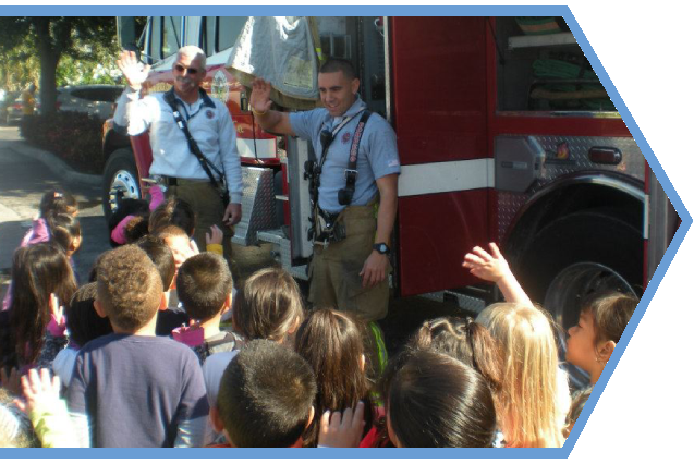 Children enjoying a school activity with the fire fighters at a Preschool & Daycare Serving Palm Springs, Lake Worth, West Palm Beach, FL